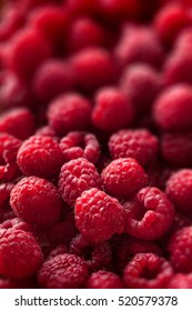 Raspberries closeup colorful large group on dark background selective focus
