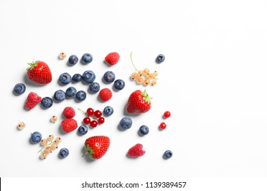 Raspberries and different berries on white background