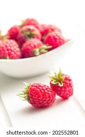 the raspberries on white table