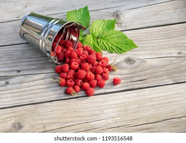 Raspberries scattered on a wooden table
