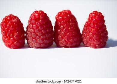 Raspberries strung, white background, fruits, summer