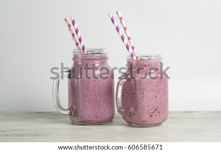 Raspberry and blueberry smoothie with yoghurt and protein