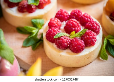 raspberry cake with cream cheese, mint on crumbly dough. Cake with raspberries