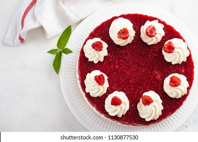 Raspberry cheesecake with fresh raspberries and mint. Top view.