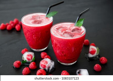 Raspberry cocktail with ice and berries. Tasty fruit smoothie