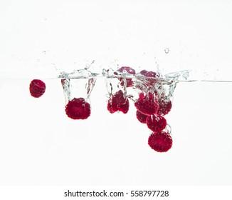 raspberry fruits making splash in water