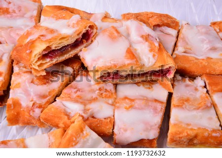 Raspberry iced and sliced Kringle a local favorite in Racine Wisconsin.