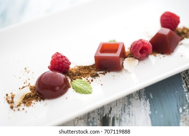 Raspberry jelly with mint and coconut flakes