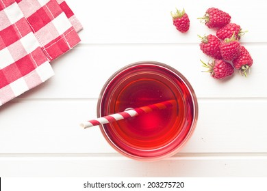 raspberry juice on white table