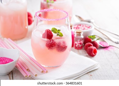 Raspberry lemonade with ice in a glass