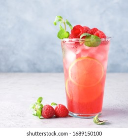 Raspberry lemonade with lime and ice. Cold refreshing cocktail