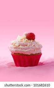 Raspberry Mascarpone Muffin with white chocolate chips on pink fabric