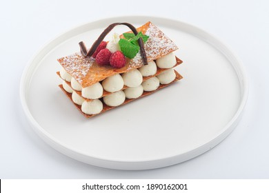 raspberry mille feuille dessert on a white plate