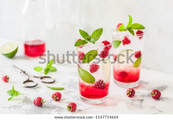 Raspberry Mojito, Syrup, Fresh Berry, Fizzy Water and Mint Cocktail, copy space for your text