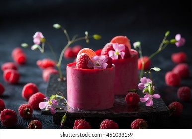 Raspberry mousse cakes with fresh berries and macaroni