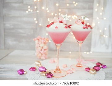Raspberry panna cotta with a white mousse au chocolat and pink popcorn