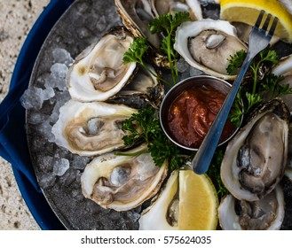 Raspberry Point oysters on the half shell with lemon and cocktail sauce