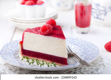 Raspberry tart, mousse cake, cheesecake with fresh raspberries on a white wooden background