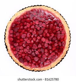 Raspberry Tart in a tart pan on a white background
