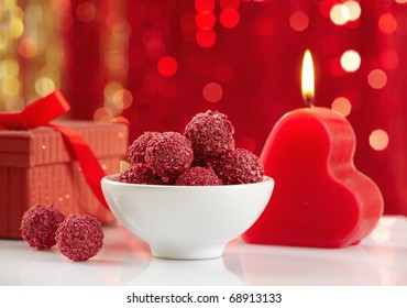 raspberry truffles and burning candle