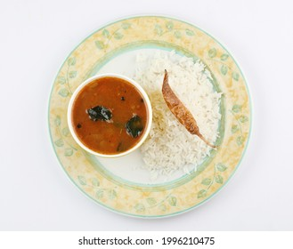 rassam and rice with fried dry red chilli