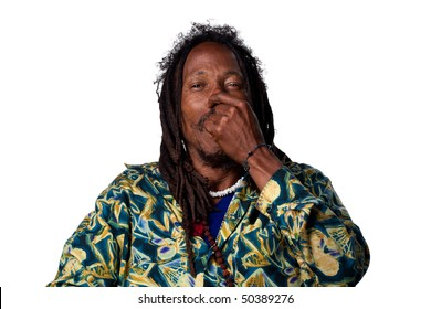 Rasta man pinches his nose due to a bad smell