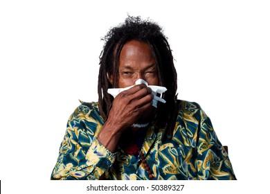 Rasta man sneezing, isolated image on white