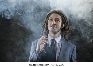 Rastafarian businessman smoking marijuana