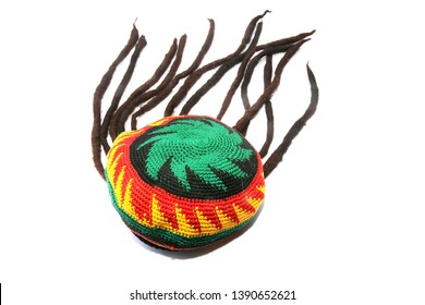 Rastafarian Hat. Isolated on white, Room for text. Rasta Hat with Dreadlocks.