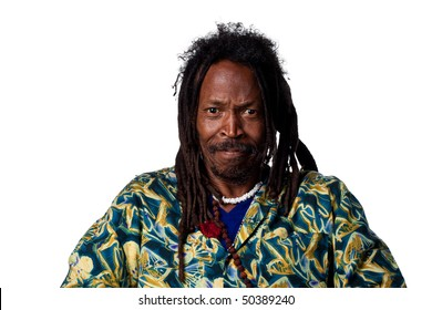 Rastafarian man grimacing at the camera, isolated on white