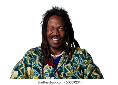Rastafarian man winking at the camera, isolated on white