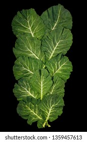 Rastan ( Collard greens, collards ) - popular leafy vegetables in Balkan cuisine - isolated on black background.  Flat lay