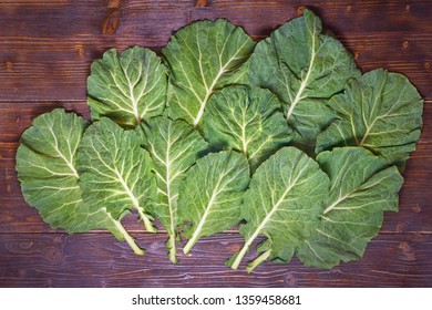 Rastan ( Collard greens, collards ) - popular leafy vegetables in Balkan cuisine. Dark rustic background, flat lay