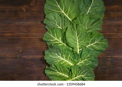 Rastan ( Collard greens, collards ) - popular leafy vegetables in Balkan cuisine. Dark rustic background, flat lay, free space for text