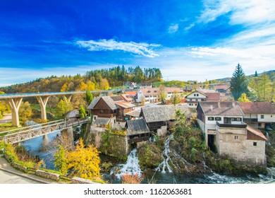 Rastoke, Slunj, Croatia, bridge over Korana river canyon and beautiful traditional village with old water mills on waterfalls, beautiful countryside landscape