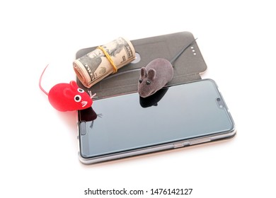 Rat toys are red, gray on the new smartphone in a case and a pack of banknotes of American dollars with a yellow elastic band. The concept of happy new year, a gift for 2020.