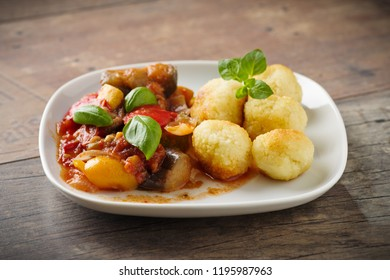 Ratatouille - french vegetable stew with tomotoes, aubergines, courgettes and peppers. Served with couscous balls