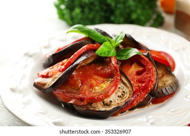 Ratatouille on plate, on table background