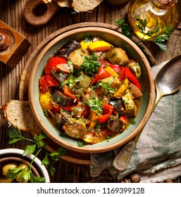Ratatouille, Vegetarian stew made of zucchini, eggplants, peppers, onions, garlic and tomatoes with addition of aromatic herbs, top view. Traditional french food, vegetable dish