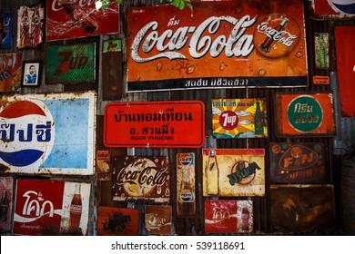 Ratchaburi, Thailand - December 4: Rust old wall vintage logo of soft drinks on December 4, 2016 in Ratchaburi, Thailand.