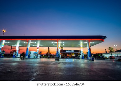 Ratchaburi, Thailand - February 2020 : View of PTT gas station at night, Ratchaburi Thailand. Select focus.