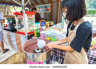 Ratchaburi, Thailand, Jul 28, 2019 - Asian woman making candyfloss or cotton candy by machine at front shop