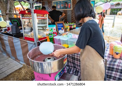 Ratchaburi, Thailand, Jul 28, 2019 - Asian woman making candyfloss or cotton candy by using machine at front shop