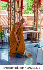 Ratchaburi, Thailand - May 24, 2014: Buddhist monk doing some cleaning  at buddhist temple from Damnoen Saduak Floating Market, Thailand.Buddhism is the primary religion in Thailand.