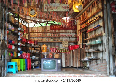 RATCHABURI, THAILAND - May18, 2019 : Ban Hom Tien is a popular spot for tourists to take pictures of various colorful aromatic candles, and there are shops decorated with rare collectibles.