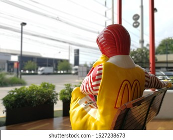 Ratchaburi/ Thailand - October 10, 2019 : McDonald restaurant in Thailand with Ronald McDonald statue sitting in front of the restaurant.