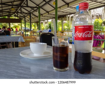 Ratchaburi , THAILAND October 14, 2018 ; Coca Cola in glass background. Fresh carbonated drink with ice in glass.
