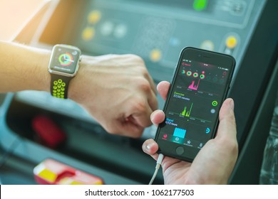 Ratchaburi,Thailand ,5 Apr 2018 : Man Comparing Activity App and check on Apple Watch and iPhone before running working out