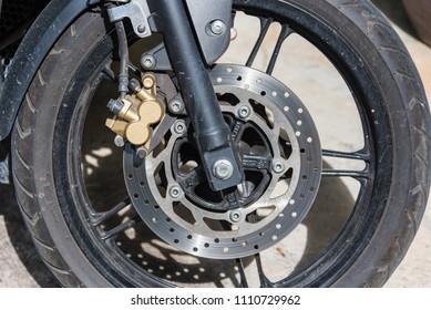 Ratchaburi,Thailand - June, 02, 2018 : Disc brakes on the front wheels of Bigbike motorcycle brand Yamaha Steed 500CC at Damnoen Saduak Floating Market in Ratchaburi,Thailand