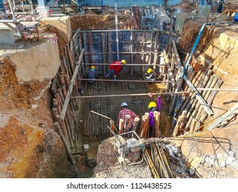 Ratchaburi,Thailand-Jun 2018: Workers proceed construction work of drainage pit by excavation the ground and make the steel structure frame before concrete in power plant construction site